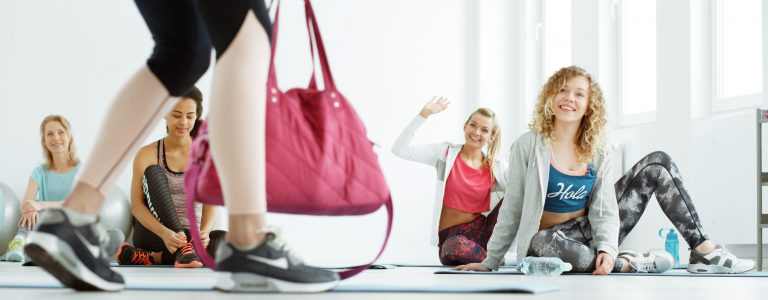 Girls waiting for pilates classes on a gym